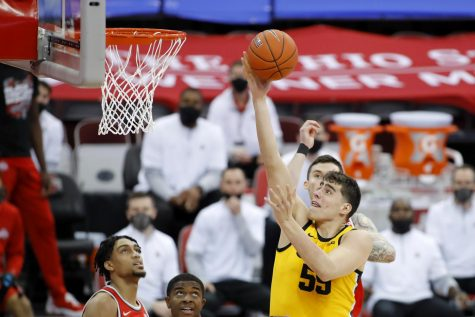 Feb 28, 2021; Columbus, Ohio, USA; Iowa Hawkeyes center Luka Garza (55) goes to the basket as Ohio State Buckeyes guard Duane Washington Jr. (4) defends during the first half at Value City Arena. Mandatory Credit: Joseph Maiorana-USA TODAY Sports