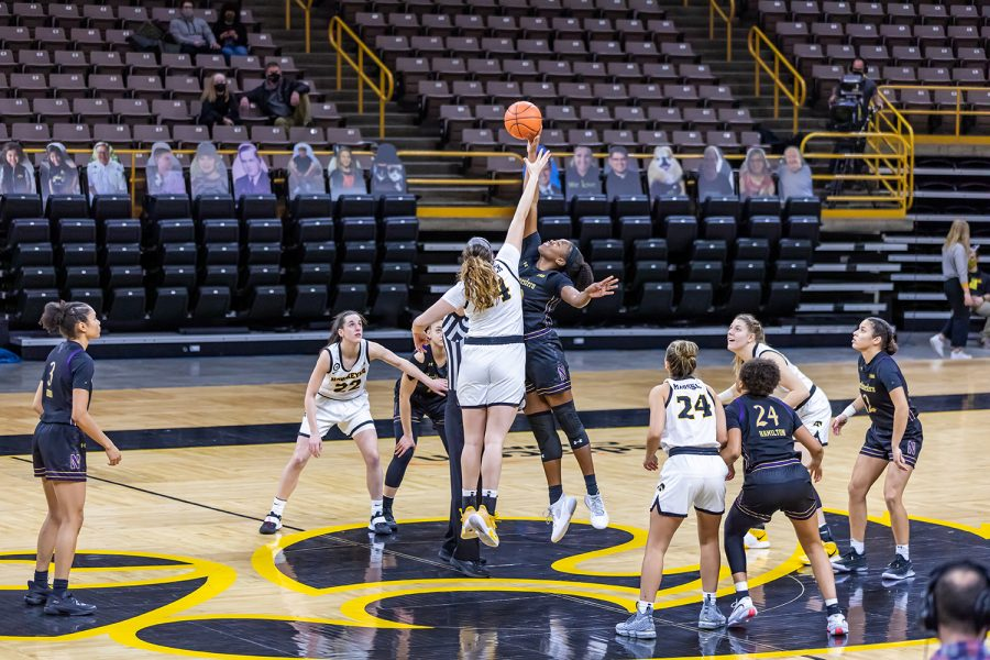 Iowa Guard/Forward McKenna Warnock and a Northwestern player tip off the ball at the start of the Iowa Women's Basketball game against Northwestern on Jan. 28, 2021 at Carver-Hawkeye Arena. Northwestern defeated Iowa 87-80.