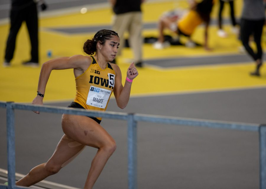 Iowa's Paige Magee runs the second leg of the Women's 4x400-meter relay premier. The relay team finished 6th during the Hawkeye B1G Invitational track meet at the University of Iowa Recreation Building on Saturday, Feb. 13 , 2021.