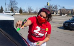 University of Iowa senior, Juliana DeSouza, decorates her car before the start of the University of Iowa Dance Marathon Parade on Saturday, Feb. 27 behind Kinnick Stadium in lot 43. Most of the other Dance Marathon events were held virtually this year due to COVID.