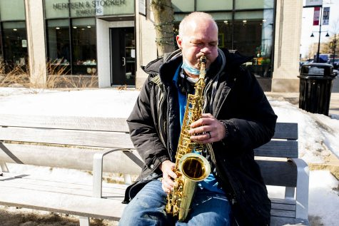 "Eddie ""The Sax Man"" Raines, plays his saxophone on Thursday, Feb. 25, 2021 at the Ped Mall. Raines has been playing the saxophone for 44 years with the last six in Iowa City."