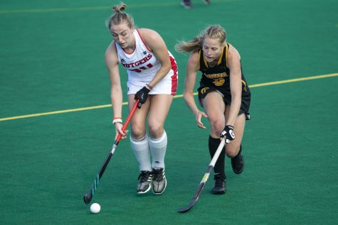 Rutgers midfielder Katie Larmour keeps the ball away from Iowa's Sofie Stribos during the Iowa field hockey match against Rutgers on Friday, Oct. 4, 2019 at Grant Field. The Hawkeyes beat the Scarlet Knights 2-1.