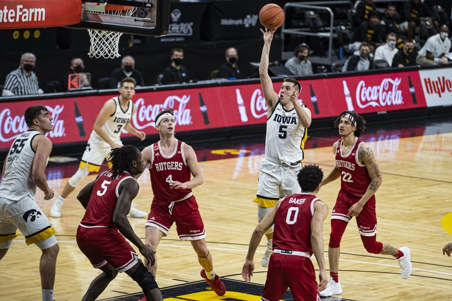 Iowa guard CJ Fredrick takes a shot during a menÕs basketball game between Iowa and Rutgers at Carver-Hawkeye on Wednesday.