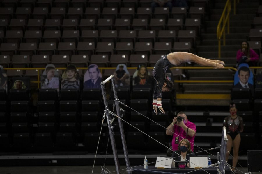 Iowa's Clair Kaji performs a bars routine during a gymnastics meet against Ohio State on Saturday, Jan. 23, 2021 at Carver Hawkeye arena. The Hawkeyes defeated the Buckeyes with a score, 196.550-193.800. Kaji earned a score of 9.850.