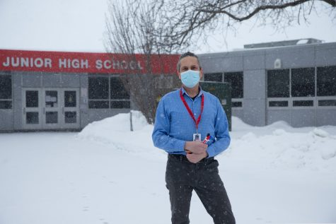 STEM teacher Bennett Brown recently resigned from teaching at Iowa City Southeast Junior High School because of state legislation requiring an in-person option learning starting February 15. Brown stands outside of Southeast Junior High School on February 13, 2021.