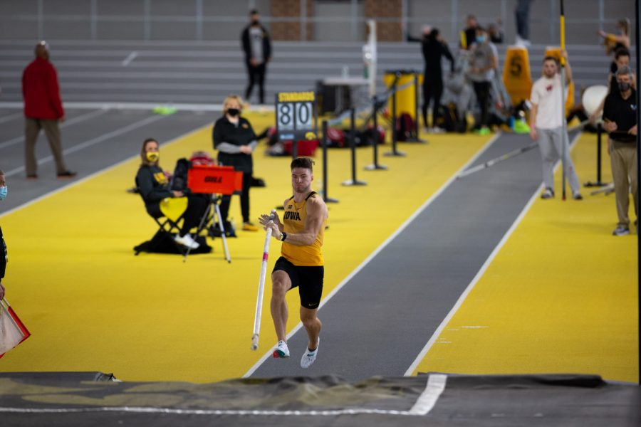 Iowa Pole Vaulter Peyton Haack runs up to his launching point. Haack finished 16th during the Hawkeye B1G Invitational track meet at the University of Iowa Recreation Building on Saturday, Feb. 13 , 2021.