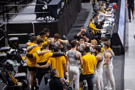 The Iowa men's gymnastics team huddles on Saturday, Feb. 20, 2021 during the Iowa vs. Penn State men's gymnastics meet at Carver-Hawkeye Arena. Iowa defeated Penn State 398.850-393.550. Men's gymnastics has not been reinstated like the women's swimming and diving team was earlier in February, so this is will be their final season.