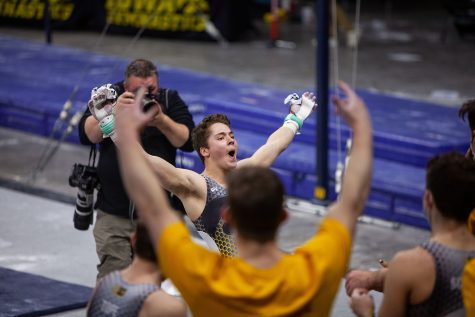 Iowa all-around James Friedman is fired up after performing on the horizontal bar on Saturday, Feb. 20, 2021 during the Iowa vs. Penn State men's gymnastics meet at Carver-Hawkeye Arena. Iowa defeated Penn State 398.850-393.550. Friedman placed tenth overall on the horizontal bar with a final score of 12.550.
