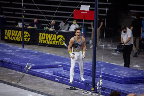 Iowa all around Evan Davis is energized after performing on the horizontal bar on Saturday, Feb. 20, 2022 during the Iowa vs. Penn State men's gymnastics meet at Carver-Hawkeye Arena. Iowa defeated Penn State 398.850-393.550. Davis tied for first on the horizontal bar with Penn State's Michael Jaroh and Matt Cormier with a final score of 13.250.
