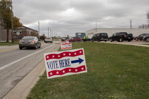Johnson County holds Drive-Up early voting in the parking ramp of the Johnson County Health and Human Services Building on Oct. 23, 2020. Voters follow signs and wait in a line of cars to cast their ballot.
