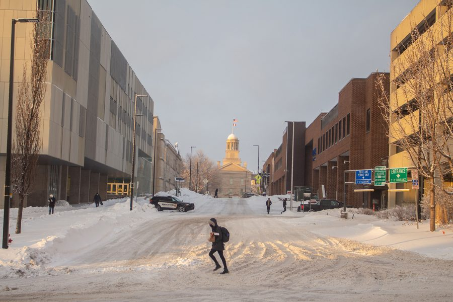 Several+students+are+seen+walking+on+the+University+of+Iowa+campus+on+Feb.+4+after+a+snowstorm+rolled+through+earlier+that+day.