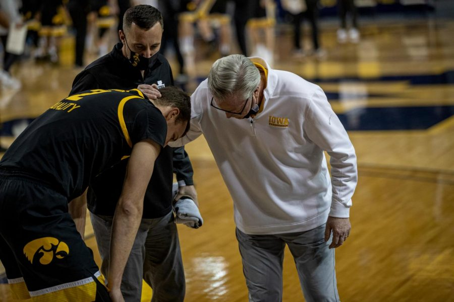 Iowa+head+coach+Fran+McCaffrey+and+Athletic+Trainer+Brad+Floy+check+on+forward+Jack+Nunge+%282%29+after+an+apparent+injury+during+the+first+half+of+a+men%E2%80%99s+basketball+game+at+the+Crisler+Center+in+Ann+Arbor%2C+Michigan+on+Thursday%2C+February+25%2C+2021.+Nunge+was+helped+off+the+floor+and+to+the+locker+room+before+later+returning+on+crutches.+McCaffrey+said+after+the+game+that+Nunge+will+undergo+an+MRI+the+following+day.+The+Michigan+Wolverines+beat+the+Iowa+Hawkeyes+by+a+score+of+79-57.+%28Jake+Maish%2FThe+Daily+Iowan%29