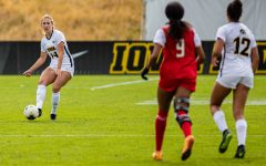 Iowa defender Sara Wheaton passes the ball during a women's soccer match between Iowa and Maryland at the Iowa Soccer Complex on Sunday, October 13, 2019. The Hawkeyes shut out the Terrapins, 4-0.