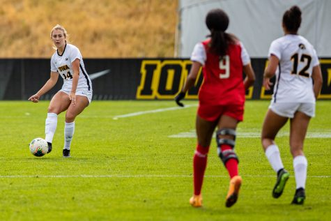 Iowa defender Sara Wheaton passes the ball during a women