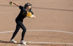 Pitcher Allison Doocy warms up during the Iowa softball fall opener against Des Moines Area Community College. The Hawkeyes beat the Bears 4-1 in 10 innings.