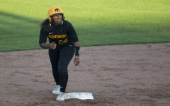 Infielder Nia Carter leads off the base during the Iowa softball fall opener against Des Moines Area Community College on Friday, Sept. 13, 2019. The Hawkeyes beat the Bears 4-1 in 10 innings.