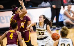 Iowa guard Caitlin Clark drives to the rim during a women's basketball game between Iowa and Minnesota at Carver-Hawkeye Arena on Wednesday, Jan. 6, 2021. The Hawkeyes defeated the Golden Gophers, 92-79.