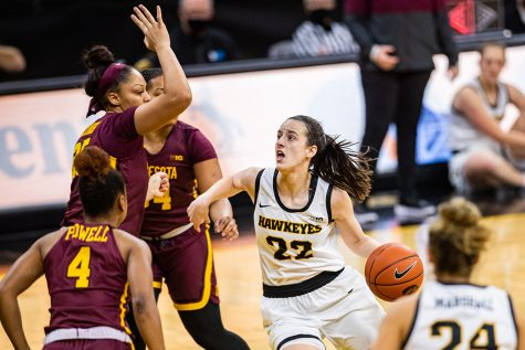 Iowa guard Caitlin Clark drives to the rim during a women