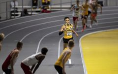Jamal Britt finishes his leg of the 4x400m relay premier during the second day of the Larry Wieczorek Invitational on Saturday, Jan. 23, 2021 at the University of Iowa Recreation Building. Britt ran a split of 48.375, contributing to the Iowa 'A' team victory with a total time of 3:09.58. Due to coronavirus restrictions, the Hawkeyes could only host Big Ten teams. Iowa men took first, scoring 189, and women finished third with 104 among Minnesota, Wisconsin, Nebraska, and Illinois. (Jenna Galligan/The Daily Iowan)