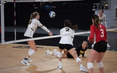 Joslyn Boyer digs the ball from the ground and passes it to teammate, Hannah Clayton, during a women's volleyball match between Iowa and Indiana at Xtream Arena on Friday, Feb. 5, 2021.