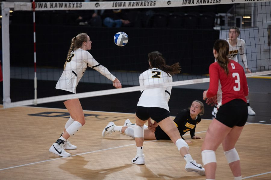 Joslyn Boyer digs the ball from the ground and passes it to teammate, Hannah Clayton, during a womens volleyball match between Iowa and Indiana at Xtream Arena on Friday, Feb. 5, 2021.