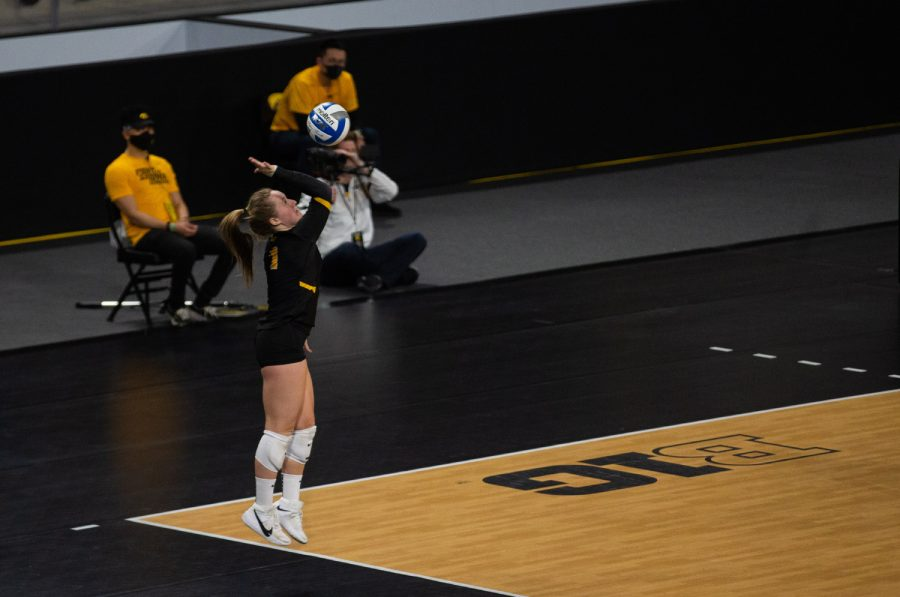 Iowa Libero Joslyn Boyer jumps up to hit a serve during a women's volleyball match between Iowa and Rutgers at Xtream Arena on Saturday, Feb. 20, 2021. The Scarlet Knights defeated the Hawkeyes 3 sets to 2.