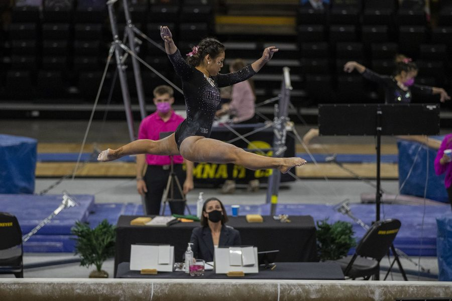 Iowa's Clair Kaji performs on the beam during a gymnastics meet against Ohio State on Saturday, Jan. 23, 2021 at Carver Hawkeye arena. The Hawkeyes defeated the Buckeyes with a score, 196.550-193.800. Kaji earned a score of 9.875.