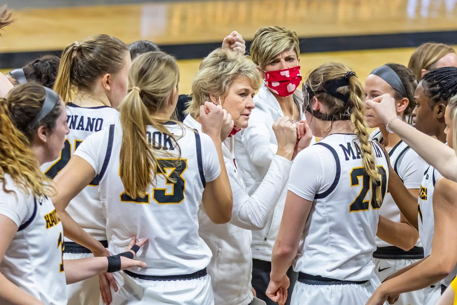 Iowa Head Coach Lisa Bluder fist bumps her team during a timeout at the Iowa Women's Basketball game against Northwestern on Jan. 28, 2021 at Carver-Hawkeye Arena. Northwestern defeated Iowa 87-80.