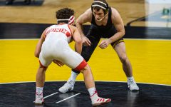 Iowa's 125-pound Spencer Lee grapples with Nebraska's Liam Cronin during a wrestling dual meet between No. 1 Iowa and No. 6 Nebraska at Carver Hawkeye Arena on Friday, Jan. 15, 2021. No. 1 Lee defeated No. 11 Cronin by tech fall in 1:21, and the Hawkeyes defeated the Cornhuskers, 31-6.
