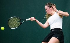 Iowa's Samantha Mannix hits a forehand during a women's tennis match between Iowa and Colorado at the HTRC on Sunday, Feb. 16, 2020.