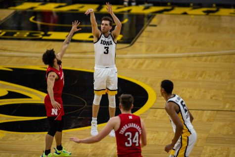 Iowa Guard Jordan Bohannon (3) shoots a three during an Iowa men's basketball game against Nebraska on Thursday, March 4, 2021 at Carver-Hawkeye arena. The Hawks beat the Cornhuskers, 102-64.