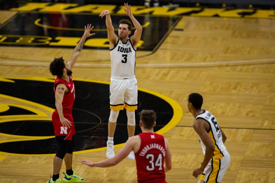 Iowa+Guard+Jordan+Bohannon+%283%29+shoots+a+three+during+an+Iowa+men%E2%80%99s+basketball+game+against+Nebraska+on+Thursday%2C+March+4%2C+2021+at+Carver-Hawkeye+arena.+The+Hawks+beat+the+Cornhuskers%2C+102-64.