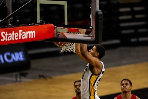 Iowa Forward Kris Murray (20) dunks the ball during an Iowa men's basketball game against Nebraska on Thursday, March 4, 2021 at Carver-Hawkeye arena. The Hawks beat the Cornhuskers, 102-64.