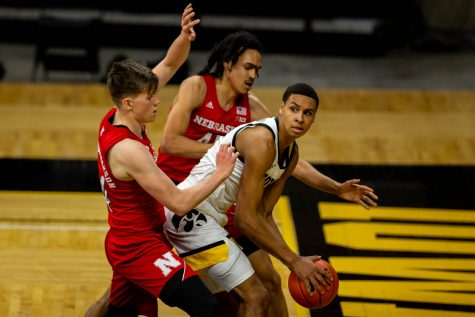 Iowa Forward Keegan Murray (15) holds the ball under the basket during an Iowa men's basketball game against Nebraska on Thursday, March 4, 2021 at Carver-Hawkeye arena. The Hawks beat the Cornhuskers, 102-64.