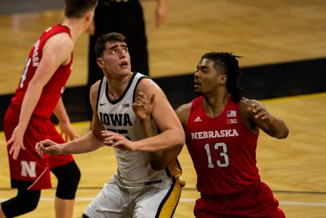 Iowa Forward Luka Garza (55) anticipates a rebound during an Iowa men's basketball game against Nebraska on Thursday, March 4, 2021 at Carver-Hawkeye arena. The Hawks beat the Cornhuskers, 102-64.