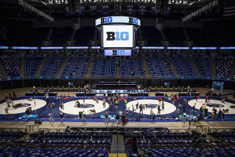 Teams participate in warmups before the Big Ten Wrestling Tournament at the Bryce Jordan Center in State College, PA on Saturday, March 6, 2021. (Ryan Adams/The Daily Iowan)