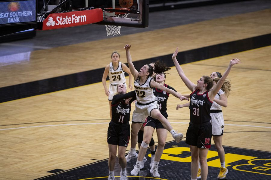 Iowa guard Caitlin Clark (22) goes for the basket during the Iowa women's basketball game v. Nebraska in Carver-Hawkeye Arena on March 6, 2021. Iowa defeated Nebraska with a score of 83-75 .