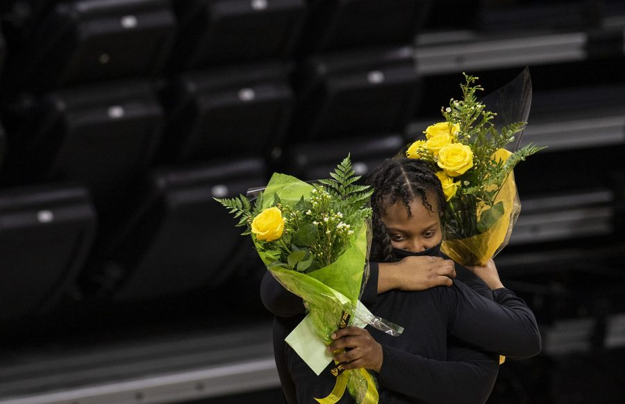 Iowa seniors Alexis Sevillian (left) and Zion Sanders (right) embrace during senior night after the Iowa women's basketball game v. Nebraska in Carver-Hawkeye Arena on March 6, 2021. Iowa defeated Nebraska with a score of 83-75 .
