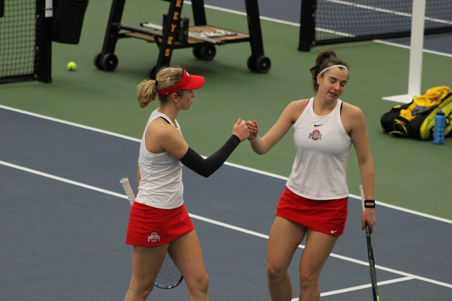 Ohio+State+doubles+partners+fist-bump+at+the+Iowa+women%27s+tennis+meet+v.+Ohio+State+on+Sunday%2C+March+7%2C+2021.+The+Hawkeyes+were+defeated+by+the+Ohio+State+Buckeye%27s+2-5.