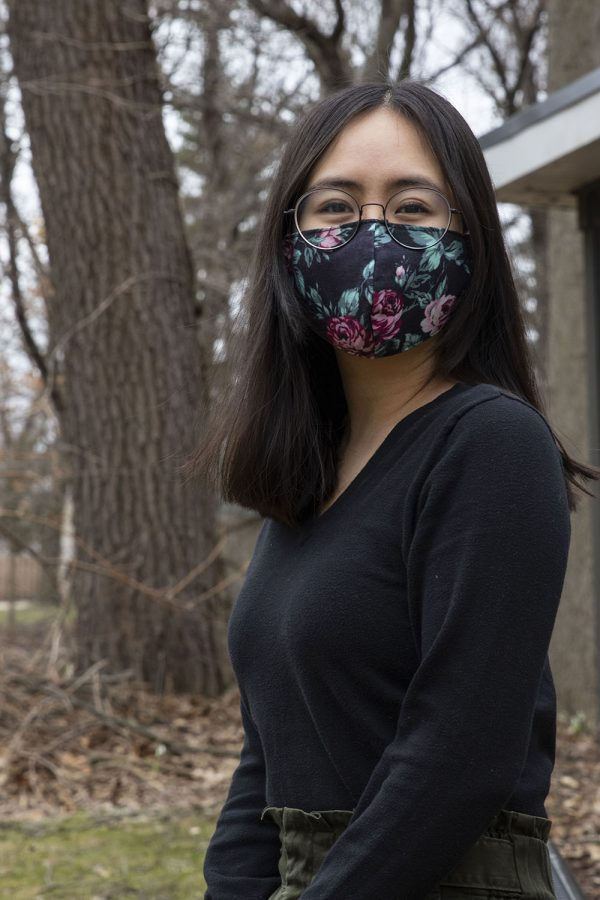 Michelle Tran-Duong poses for a portrait outside of the Asian Pacific American Cultural Center on March 11, 2021.