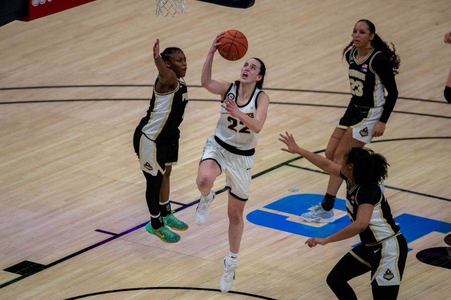 Iowa+Guard+Caitlin+Clark+%2822%29+goes+up+for+a+layup+during+a+second+round+game+of+the+Big+10+women%E2%80%99s+basketball+tournament.+Iowa%2C+ranked+%236%2C+took+on+%2311+Purdue+in+Indianapolis+at+the+Bankers+Life+Fieldhouse+Wednesday+night.+The+Hawkeyes+beat+the+Boilermakers%2C+83-72%2C+advancing+the+Hawks+to+take+on+Rutgers+Thursday+night+in+the+Big+10+quarterfinals.+