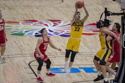 Iowa forward Patrick McCaffery shoots a basket during the Big Ten men