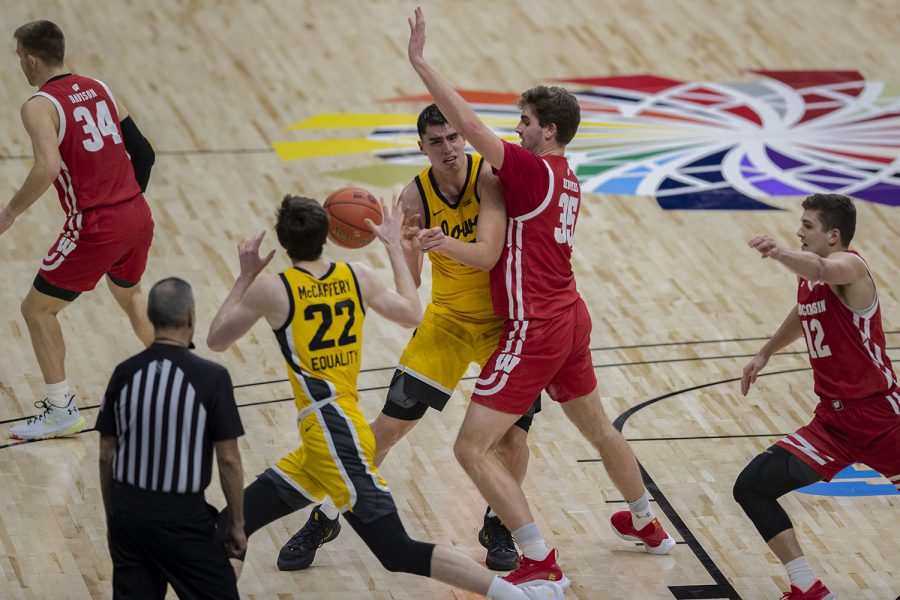 Iowa center Luka Garza passes the ball during the Big Ten men's basketball tournament quarterfinals against Wisconsin on Friday, March 12, 2021 at Lucas Oil Stadium in Indianapolis. The Hawkeyes defeated the Badgers, 62-57. No. 3 Iowa will go on to play No. 2 Illinois tomorrow afternoon in the semifinals.