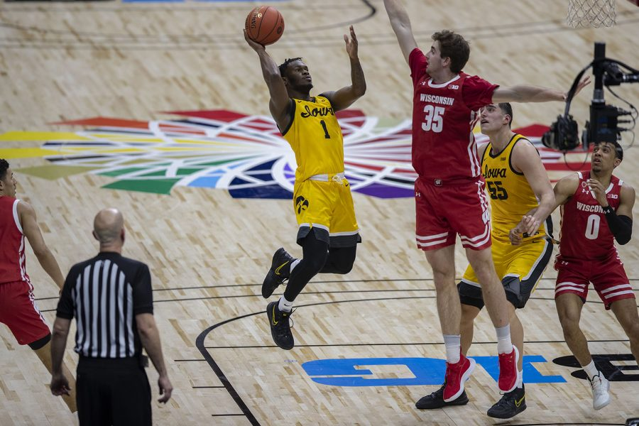 Iowa guard Joe Toussaint attempts to score during the Big Ten men