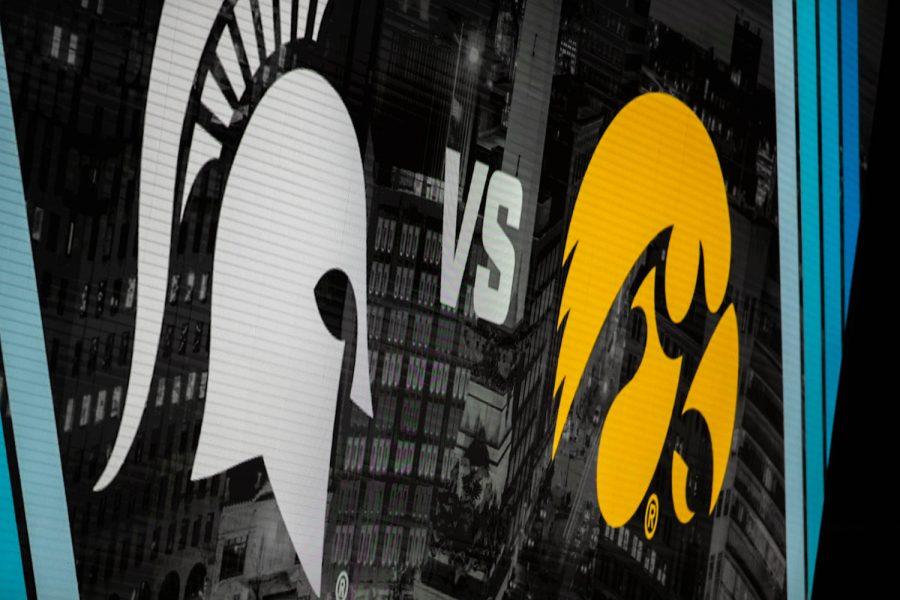 Iowa+and+Michigan+State%27s+logos+are+seen+at+a+semifinal+game+of+the+Big+Ten+women%E2%80%99s+basketball+tournament.+Iowa%2C+seeded+No.+6%2C+took+on+No.+7+seeded+Michigan+State+in+Indianapolis+at+the+Bankers+Life+Fieldhouse+Friday+afternoon.+The+Hawks+beat+the+Spartans%2C+87-72%2C+advancing+the+Hawks+to+take+on+Maryland+Saturday+in+the+Big+Ten+finals.