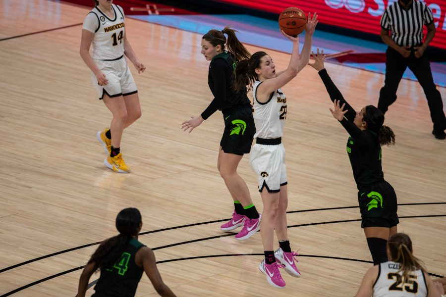 Iowa Guard Caitlin Clark (22) takes a shot during a semifinal game of the Big Ten women's basketball tournament. Iowa, ranked No. 6, took on No. 7 seeded Michigan State in Indianapolis at the Bankers Life Fieldhouse Friday afternoon. (Kate Heston/The Daily Iowan)