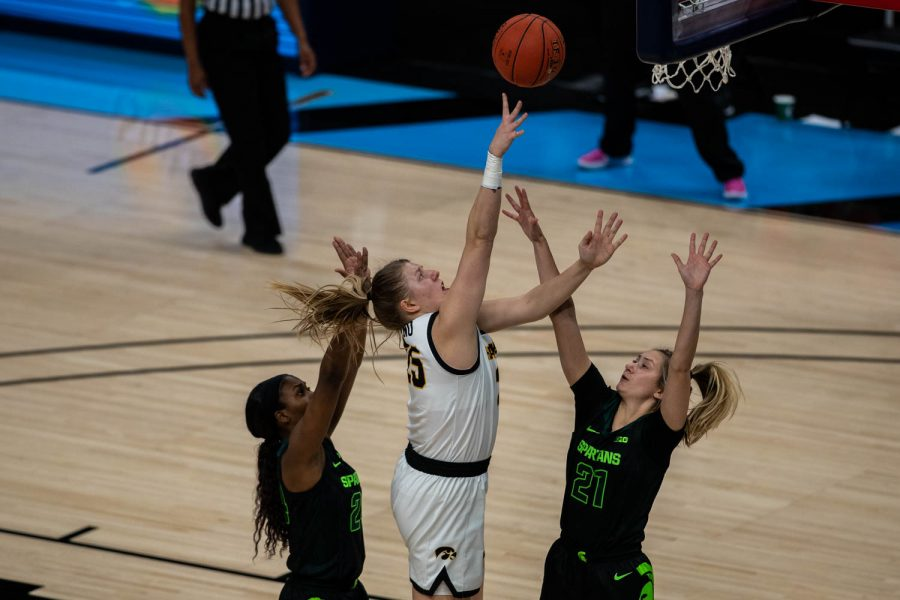 Iowa's Monkia Czinano (25) takes a shot during a semifinal game of the Big Ten women's basketball tournament. Iowa, ranked No. 6, took on No. 7 seeded Michigan State in Indianapolis at the Bankers Life Fieldhouse Friday afternoon.
