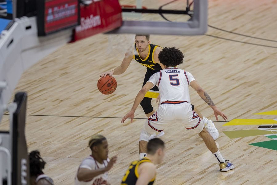 Iowa+guard+Jordan+Bohannon+looks+at+the+scoreboard+and+dribbles+the+ball+during+the+Big+Ten+men%27s+basketball+tournament+semifinals+against+Illinois+on+Saturday%2C+March+13%2C+2021+at+Lucas+Oil+Stadium+in+Indianapolis.+The+Hawkeyes+were+defeated+by+the+Fighting+Illini%2C+82-71.+No.+2+Illinois+and+No.+5+Ohio+State+will+compete+in+the+championship+game+tomorrow+afternoon.
