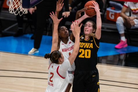 Iowa guard Kate Martin (20) goes up for a shot during the championship game of the Big Ten women's basketball tournament. Iowa, ranked No. 6, took on No. 1 seeded Maryland in Indianapolis at the Bankers Life Fieldhouse Saturday afternoon. Maryland beat Iowa, 104-84, securing their spot as the 2021 Big Ten Champions.