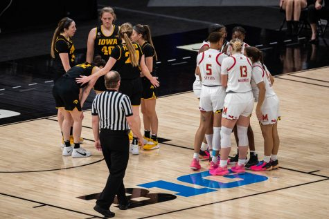 Both Iowa and Marylands womens basketball teams are seen during the championship game of the Big Ten women's basketball tournament. Iowa, ranked No. 6, took on No. 1 seeded Maryland in Indianapolis at the Bankers Life Fieldhouse Saturday afternoon. Maryland beat Iowa, 104-84, securing their spot as the 2021 Big Ten Champions. (Kate Heston/The Daily Iowan)